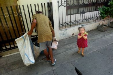 Ragpicker with foreign child
